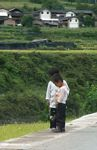 Two young kids along a road in Yunnan