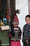Chinese girl and boy working at a stand near a passport checkpoint on the Karakoram highway