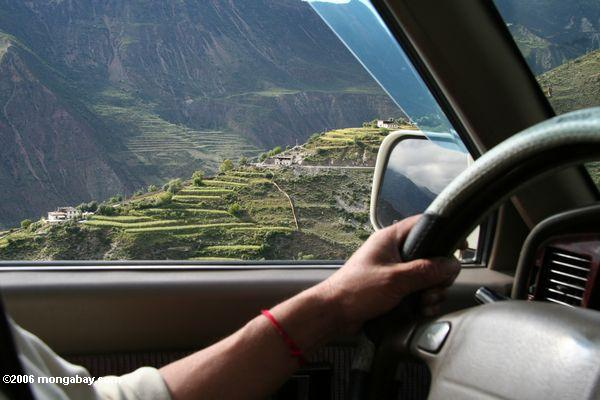 looking out the car window to tibetan village with