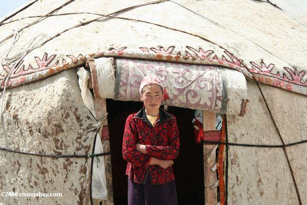 Uighur woman in front of her yurt in China. Photo by Rhett A. Butler.