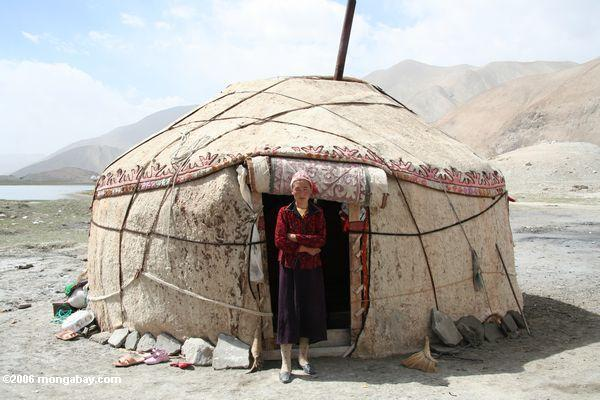 Uighur woman in front of her Lake Karakul yurt