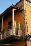 Religious statues on a balcony in Old Cartagena