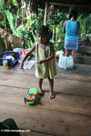 Ticuna child playing with a plastic toy