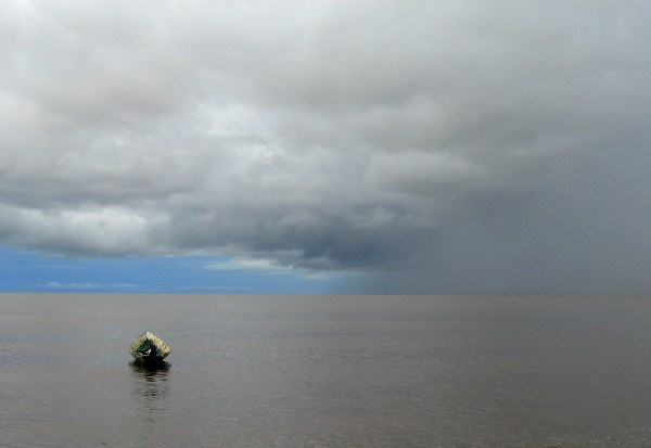 Rain coming in over boat