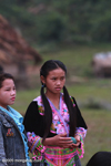 Hmong girl waiting for boys to play pov pob, a traditional ball-tossing courtship game
