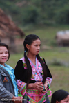 Girl waiting for boys to play pov pob, a traditional ball-tossing courtship game among the Hill tribes in Laos