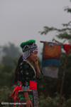 Hmong girl in traditional clothes chatting on her mobile phone