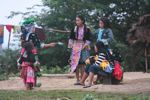 Girls preparing to play pov pob, a traditional Hmong courtship game