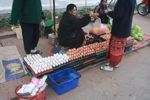Woman with many eggs in the Luang Prabang morning market