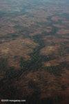 Aerial photos of forest fragments and riparian forest strips on an otherwise deforested plain in Southern Laos