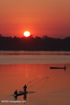 Men fishing on the Mekong as the sun comes up