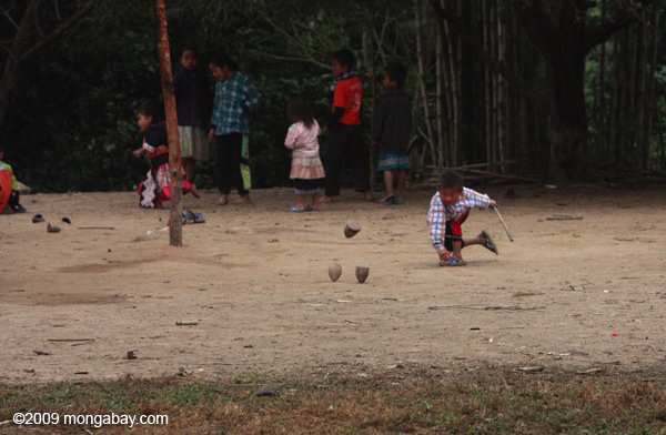 Kids playing a traditional top spinning game