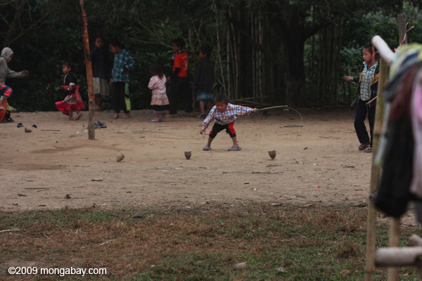 Children playing a traditional Lao top spinning game