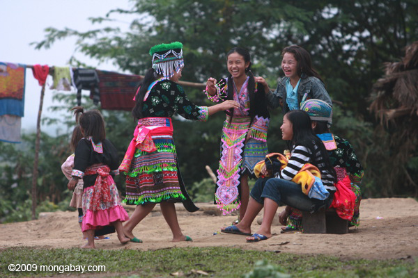 Hmong girls waiting to play pov pob, a traditional ball-tossing courtship game. Photo by: Rhett A. Butler.