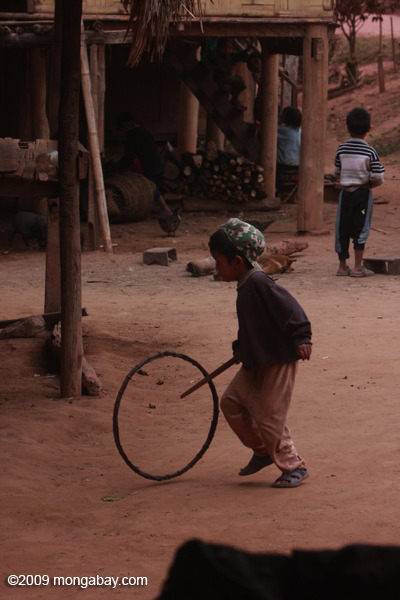 Boy pushing a hoop with a stick