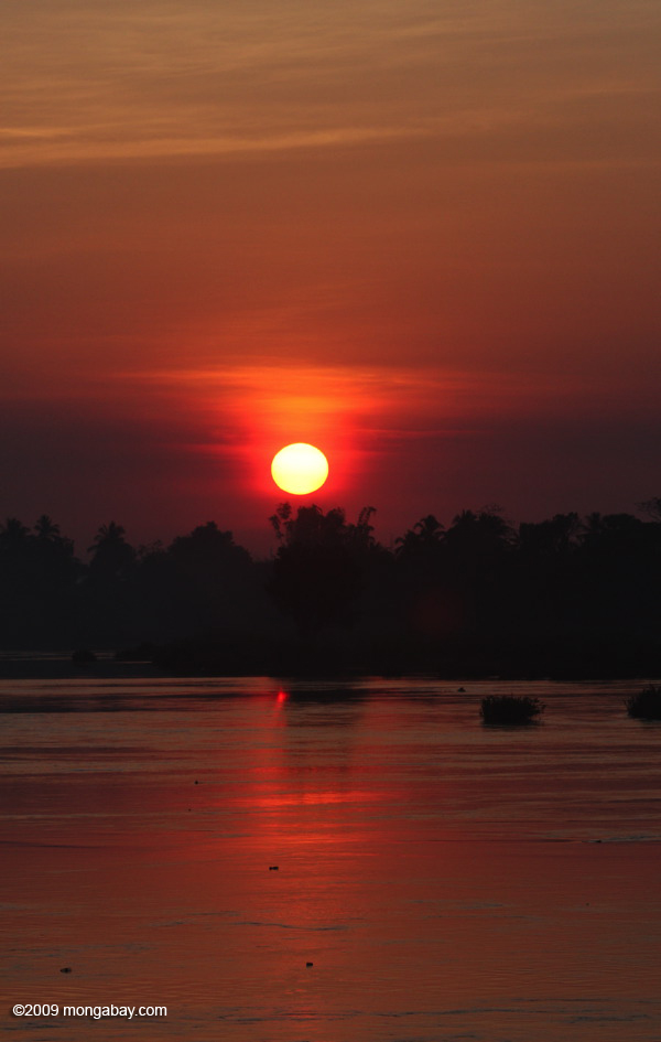 sun coming up over the mekong river