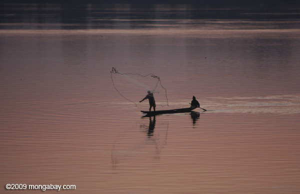 Fisherman at daybreak on the Mekong