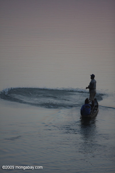 Fisherman at dawn on the Mekong
