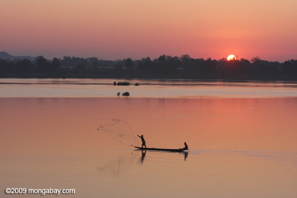 Men fishing on the Mekong at daybreak