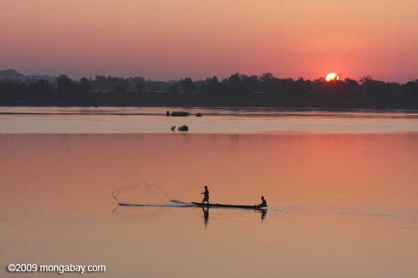 Men fishing on the Mekong at sunrise