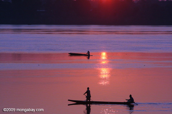 Men fishing on the Mekong in the early morning