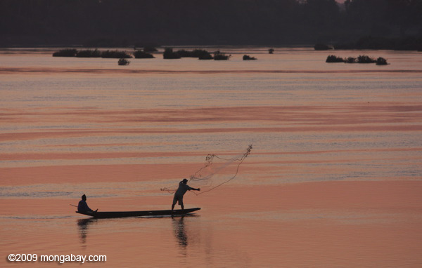 Men fishing on the Mekong at dawn