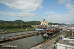Container ship passing through the Miraflores lock of the Panama canal