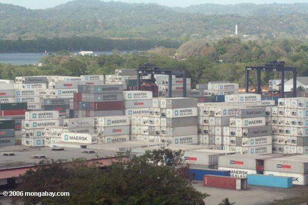 Maersk shipping containers, each with a wood floor, stacked up along the Panama Canal. Photo by: Rhett A. Butler.