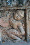 Stone carving of a croaching figure at Wat Phra That Pu Khao